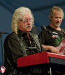 American folk legend, Arlo Guthrie, played a set of music in the Blues Tent at the 2011 Jazzfest that cannot be described in words. Veteran Jazzfest goers experience this regularly. Music sets that leave one speechless are the rule rather than the exception at the festival. - Photo by Captain Brian Epstein