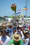 "One of the ways that music lovers at the Jazzfest tell their friends ""I'm over here."" is by carrying totems. Many of these are works of art that have evolved over the years. The Fess Head, modeled after late New Orleans piano legend, Professor Longhair, is just such one and is familiar to most diehard Jazzfest who have been in attendance over the years. - Photo by Captain Brian Epstein"