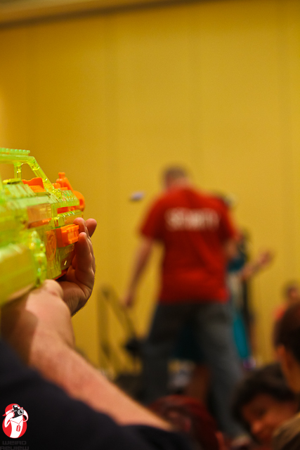 The Lone Gunman sends a nerf bullet speeding towards the chief of security
