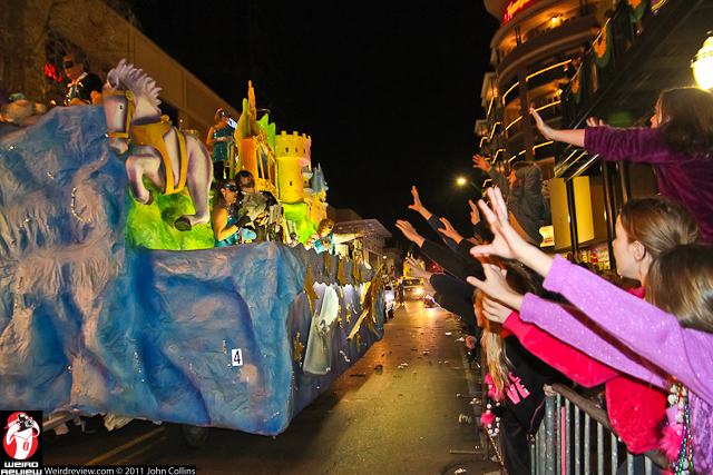 Hands and voices rose as the floats drove past
