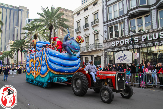 Members of the Pontchartrain Krewe rolling down Canal