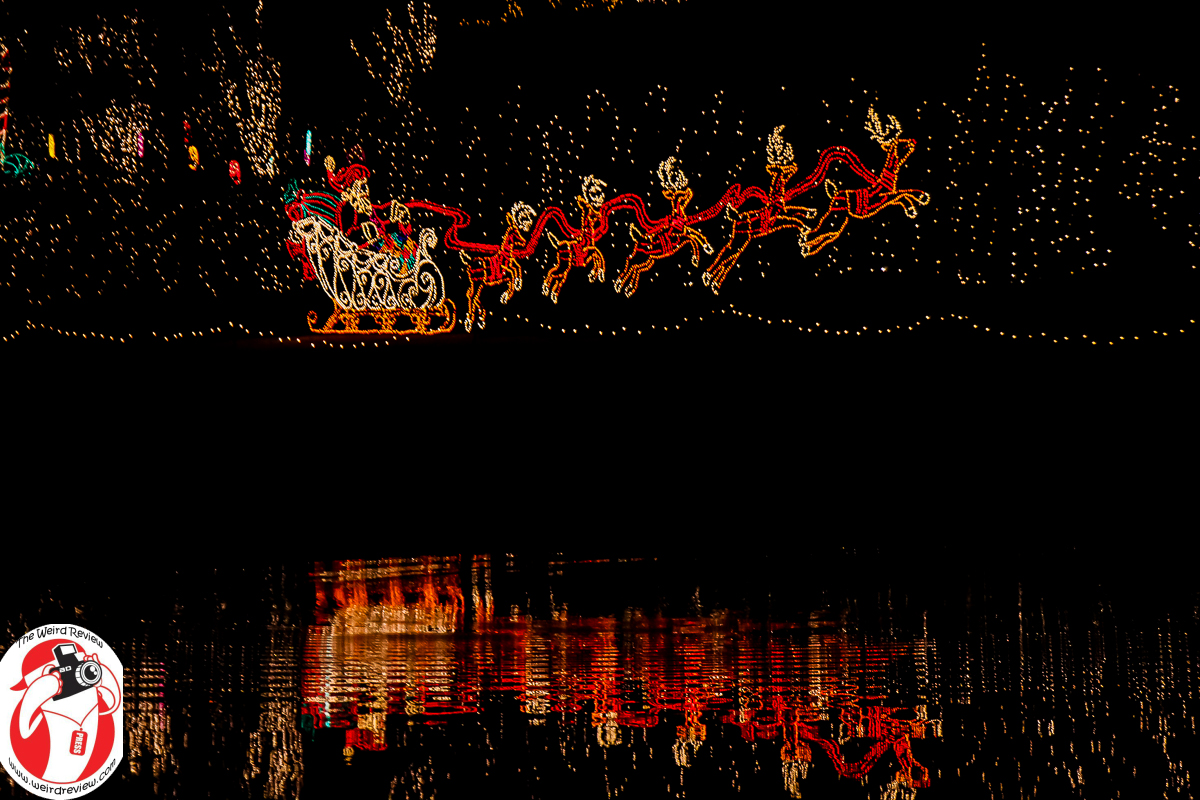 Santa and his sleigh fly over the lake at the Bellingrath Gardens