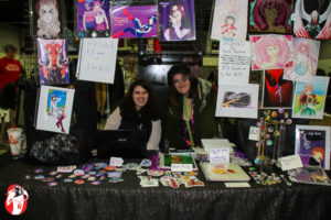 Artists Misty and Sara selling their wares