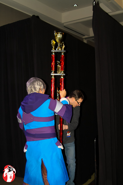 The trophy for Best in the Show took two people to carry it in